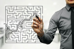 Businessman trying to find way out of maze. Conceptual image of businessman trying to find way out of maze Royalty Free Stock Images