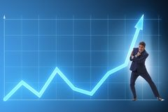 The businessman trying to help economic growth in business concept. Businessman trying to help economic growth in business concept stock photos