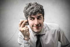 Businessman trying to listen to something Royalty Free Stock Photo