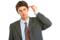 Businessman trying to plug usb flash in head Royalty Free Stock Photography