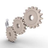 Businessman trying to reach the top of cogwheels. 3d businessman walking on cogwheels in order to reach the top Royalty Free Stock Photography