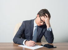Businessman trying to solve the problem Stock Photo