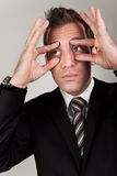 Businessman trying to stay awake. By propping his eyes Royalty Free Stock Photography