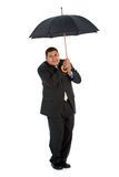 Businessman:  Trying to Stay Dry. Series of a Hispanic businessman in suit, isolated on white, with props, in various poses Stock Photos