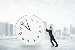 Businessman trying to stop time concept Royalty Free Stock Images