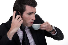 Businessman trying to talk Stock Images