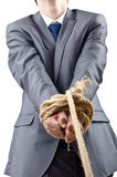 Businessman - the tug of war concept. Businessman in the tug of war concept Stock Photos