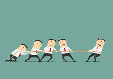 Businessman tug of war with group. Successful and powerful businessman competing with group of businessmen in a tug of war battle, for leadership or business Royalty Free Stock Photo