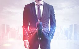 Businessman in tunnel over foggy city royalty free stock photo