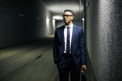 Businessman in tunnel Stock Images