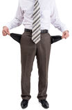 Businessman turned out his pockets Royalty Free Stock Photo