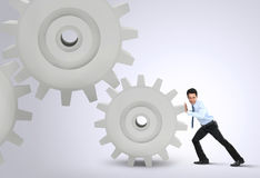 Businessman Turning a Gear stock photography