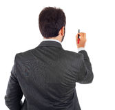 Businessman turning his back to camera with pen Stock Photography