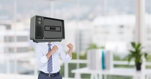 Businessman with TV on head standing in fighting posture Royalty Free Stock Photography