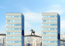 Businessman between two buildings Royalty Free Stock Images