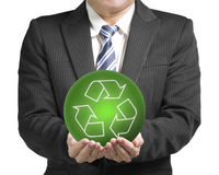 Businessman two hands hold green ball with recycle symbol isolat. Ed in white background Royalty Free Stock Images