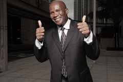 Businessman with two thumbs up Royalty Free Stock Photos
