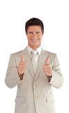 Businessman with two thumbs up Stock Images
