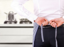 Businessman tying apron strings. Royalty Free Stock Photo