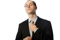 Businessman tying gallow tie Stock Photo