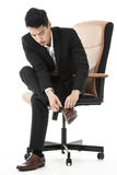Businessman tying his shoe lace Royalty Free Stock Photos
