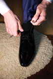 A businessman tying his shoelaces Royalty Free Stock Photo