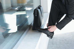Businessman Tying His Shoes Stock Photo