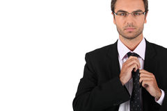 Businessman tying his tie Stock Photography