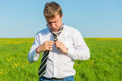 Businessman tying his tie striped Royalty Free Stock Photo