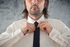 Businessman tying necktie Stock Photography