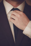 Businessman  is tying the necktie. Businessman in suit is tying the necktie Royalty Free Stock Photo