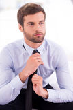 Businessman tying a necktie. Stock Image