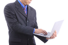 Businessman type on laptop with white backgound Royalty Free Stock Photo