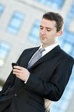 Businessman typing on the cell phone Royalty Free Stock Images