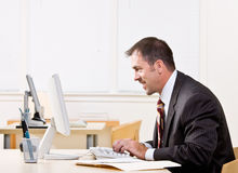 Businessman typing on computer Royalty Free Stock Photos