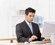 Businessman typing on computer Royalty Free Stock Photography