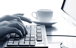 Businessman typing on a computer keyboard Stock Images