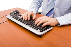 Businessman typing in the computer keyboard Stock Images