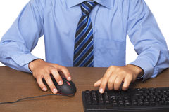 Businessman typing on computer keyboard Royalty Free Stock Photography