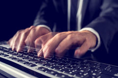 Businessman typing on a computer keyboard Royalty Free Stock Photography