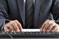 Businessman typing computer keyboard Stock Images