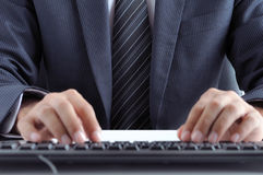 Businessman typing computer keyboard Stock Photos
