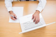 Businessman typing on computer keyboard Stock Photography