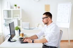 Businessman typing on computer keyboard at office Stock Photography