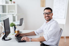 Businessman typing on computer keyboard at office Royalty Free Stock Photos