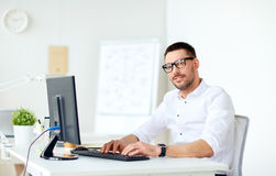 Businessman typing on computer keyboard at office Stock Image