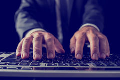 Businessman typing on computer keyboard Royalty Free Stock Image