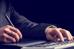 Businessman typing on a computer keyboard Stock Photos