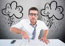 Businessman typing on desktop computer with lightning cloud in background. Digital composition of businessman typing on desktop computer with lightning cloud in stock photo