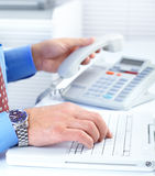 Businessman typing and dialing Stock Photo